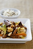 Fried turkey strips with vegetables and mushrooms