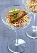 Carrot & cheese salad with toasted white bread in two glasses