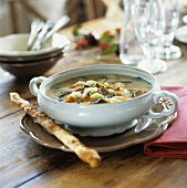 Potato soup with mushrooms and savoury stick