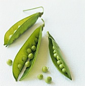 Opened pea pod with peas