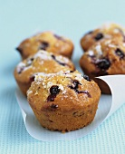 Five blueberry muffins with lemon sugar