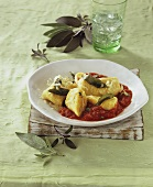 Potato dumplings on tomato sauce with sage and Parmesan