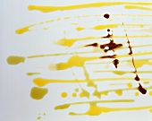 Various types of oil on a sheet of glass