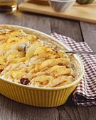 Potato and celeriac gratin in a baking dish