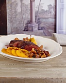 Loin of venison with chanterelles and saffron apples