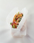 Wasabi chicken breast with vegetables baked in parchment paper