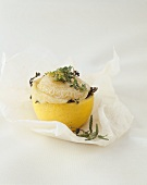 Goat's cheese with herbs in lemon, baked in parchment paper