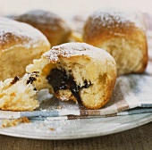 Sweet dumplings with damson filling, dusted with icing sugar