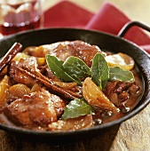 Pork stew with cinnamon and bay leaves