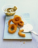 Breaded squid rings with avocado dip