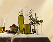 Olive oil in bottles & glasses, olive branches, sweet chestnuts