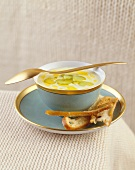 Cream of celery soup with olive oil and toast