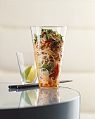 Asian glass noodle salad with shrimps in a glass
