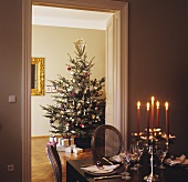 Decorated Christmas tree, gifts, festive table