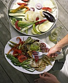 Barbecued and raw vegetables on platters