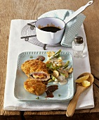 Chicken Cordon Bleu with thyme jus and vegetables