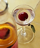 Home-made cherry liqueur in carafe and glass