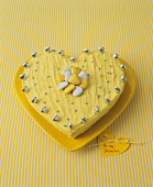 Yellow heart-shaped cake for Valentine's Day