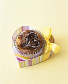 Banana cupcake with dulce de leche topping in heart-shaped box