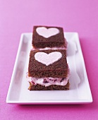 Ginger cake with rhubarb fool filling and sugar hearts