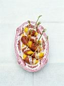 Ham-wrapped peach slices on cocktail sticks
