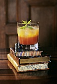 Campari Orange and Grapefruit on a pile of books