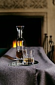 Brandy in carafe and glass in front of open fire