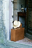 Suitcaise and hat in a house doorway