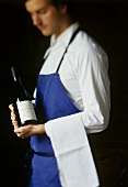 Sommelier with a bottle of wine