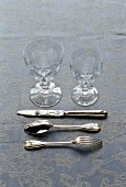 Silver cutlery with two glasses