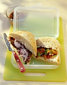 Ciabatta filled with steak tartare and peppers in lunch box