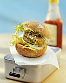 Chicken burger with salad and sprouts on a lunch box