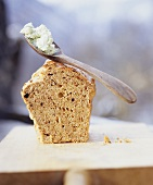 Spelt olive bread with soft cheese and basil spread