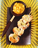 Coconut prawn skewers with chilli mango puree