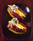 Dates stuffed with mango and soft cheese