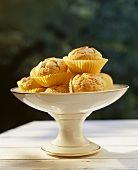 Lemon muffins on a cake stand out of doors