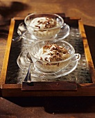 Coffee quark cream with chocolate in two cups and saucers
