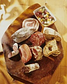 Ticino sausage platter with bread and pickled vegetables