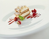 Layered coffee sponge & vanilla mousse with strawberry sauce
