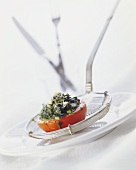 Tomato stuffed with cheese and chard on a skimmer