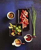 Meat, vegetables and dips for shabu-shabu