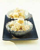 Sesame sweets in two small dishes
