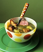 Spinach and vegetable soup with sausage
