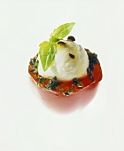 Tomato stuffed with mozzarella and basil oil