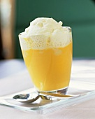 Pumpkin and orange soup with whipped cream in a glass