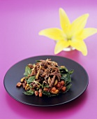 Duck and melon salad with cashew nuts and Asian dressing
