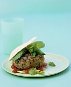 Lamb burger with mint and tomato sauce in pita bread