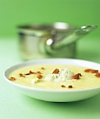 Celeriac soup with blue cheese and diced bacon