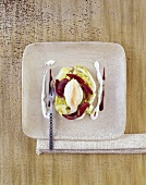 Smoked herring mousse on salad leaves with red wine onions