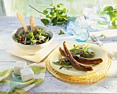 Sausages with bean and bacon salad